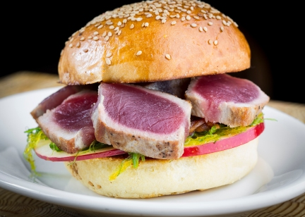 Today's #1 Tuna -- Seared Hawaiian #1-grade Ahi tuna mounded on sliced Fuji apple, red onions pickled in-house with agave and ponzu, wakame (seaweed), with ginger dressing on Bennison's Bakery sesame seed bun.